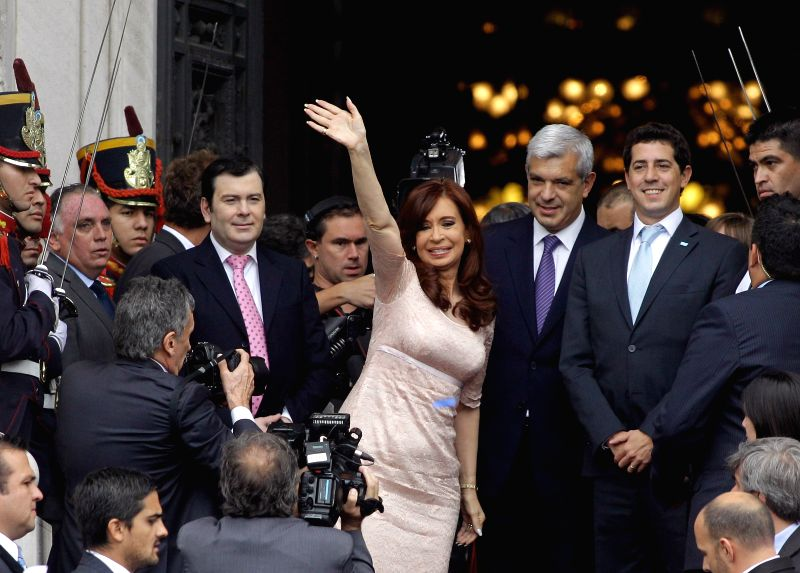Argentina's President Cristina Fernandez (C) greets the attendees after the inauguration assembly of the 133rd period of regular sessions of the National ...