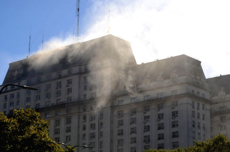 Smoke rises from a column of a building in Buenos Aires, Argentina, on March 11, 2015. The fire was caused by a short circuit in the electrical panel of one ...