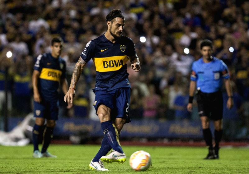 Daniel Osvaldo (C) of Argentia's Boca Juniors, shoots a penalty during the Copa Libertadores match against Zamora of Venezuela, in the Alberto J. Armando ...