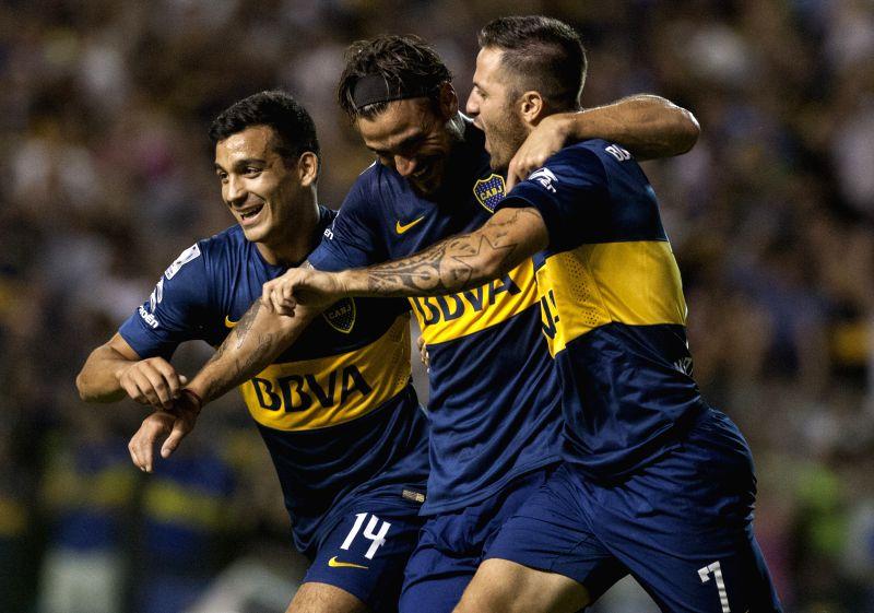 Daniel Osvaldo (C) of Argentia's Boca Juniors, celebrates his scoring with his teammates during the Copa Libertadores match against Zamora of Venezuela, in ...