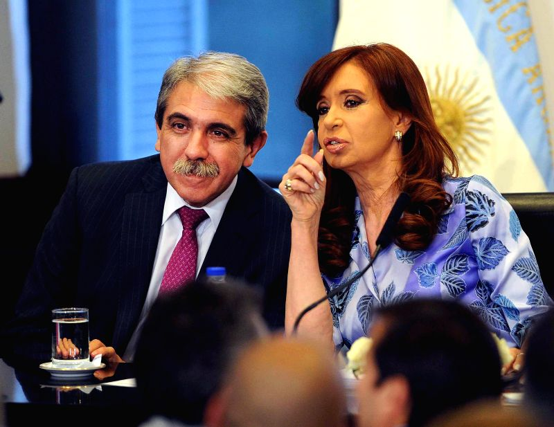 Argentina's President Cristina Fernandez (R) talks with Anibal Fernandez (L), head of Ministers Cabinet, during an act at Casa Rosada, in Buenos Aires, ... - Cabinet