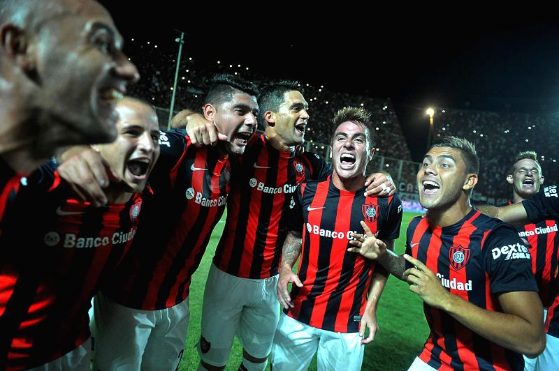 San Lorenzo's players celebrate after the match corresponding to the first division championship of the Argentine soccer against Huracan, in the Pedro ...