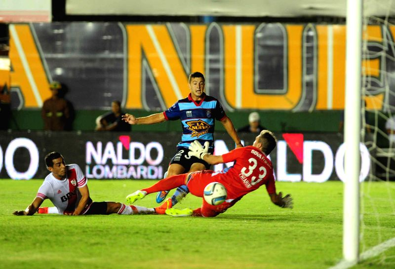 Arsenal de Sarandi's Ramiro Carrera (C) shoots the ball during the match corresponding to the first division championship of the Argentine soccer against ...