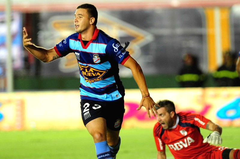 Arsenal de Sarandi's Ramiro Carrera celebrates his score during the match corresponding to the first division championship of the Argentine soccer against ...