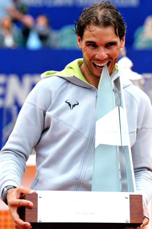 Spain's Rafael Nadal bites the trophy after winning the final match against Agentina's Juan Monaco, during the Argentina tennis Open 2015, in Buenos Aires, ...