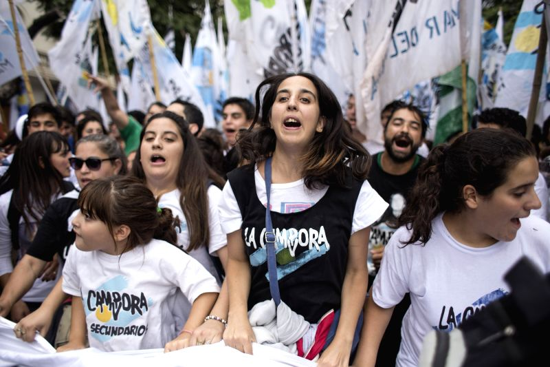 Residents take part in a march marking the 39th anniversary of the coup of 1976, at Plaza de Mayo Square in Buenos Aires, capital of Argentina, on March 24, ...