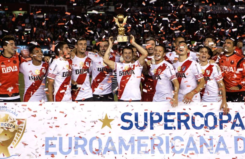 River Plate's players of Argentina celebrate with the trophy after the match of Euroamerican Super Cup, against Sevilla of Spain, held at Antonio Vespucio ...