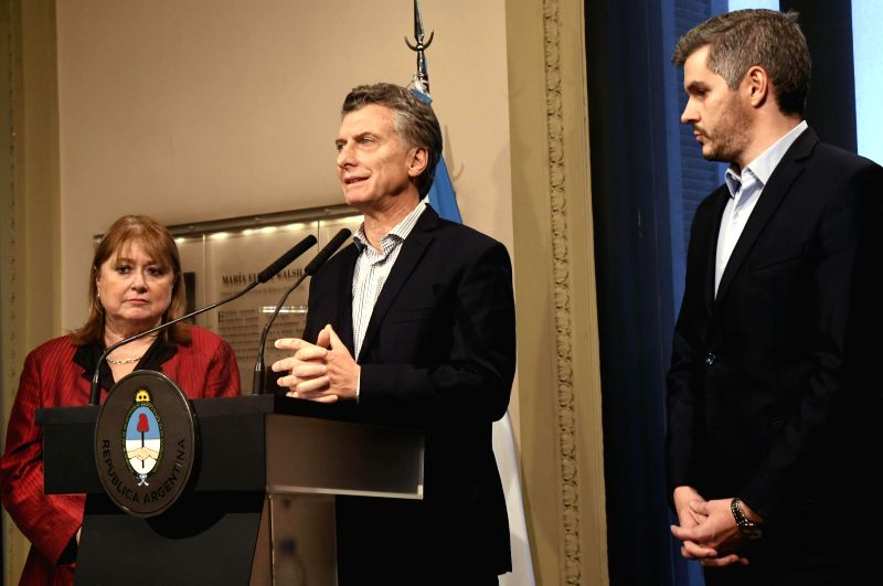 BUENOS AIRES, May 30, 2017 - Argentina's President Mauricio Macri (C) speaks while Foreign Minister Susana Malcorra (L) looks on during a news conference in Buenos Aires May 29, 2017. Mauricio Macri ... - Susana Malcorra