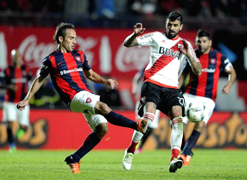 BUENOS AIRES, May 8, 2016 - River Plate's Luis Oscar Gonzalez (R) vies for the ball in the match against San Lorenzo of the First Division of Argentina at Pedro Bidegain Stadium in Buenos Aires, ...