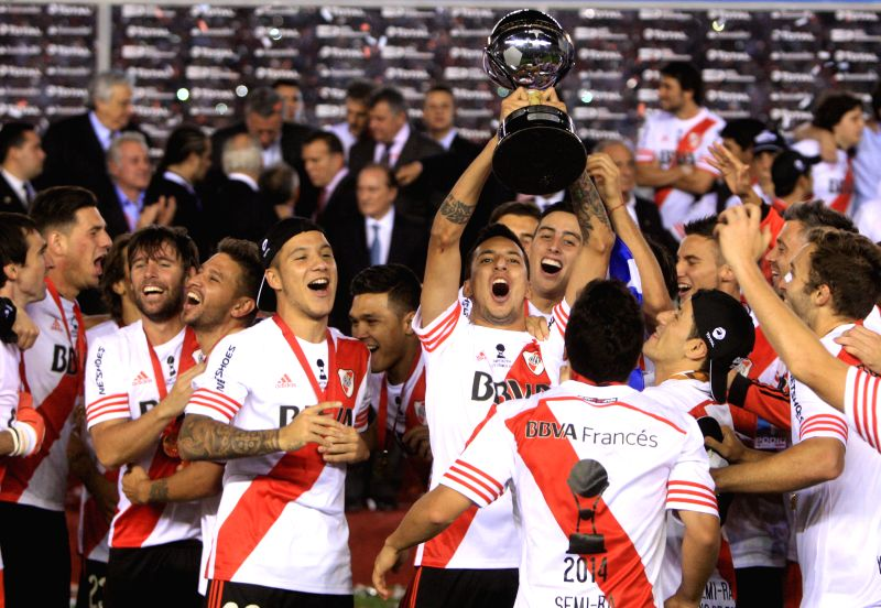 Buenos Aires: River Plate's players celebrate with the trophy after the second leg of the South American Cup 2014 final match against Atletico National in Buenos Aires, capital of Argentina, on Dec. .