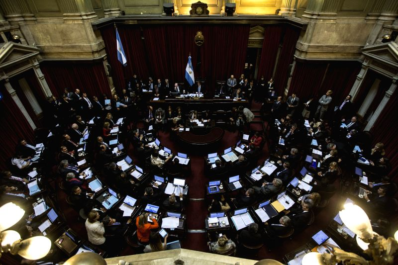 Legislators take part in the special session of the National Congress in Buenos Aires city, capital of Argentina, on Sept. 3, 2014. Legislators debated in a ...