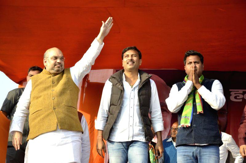 BJP chief Amit Shah during a rally in Bundu of Jharkhand on Nov 24, 2014. Also seen AJSU supremo Sudesh Mahato.