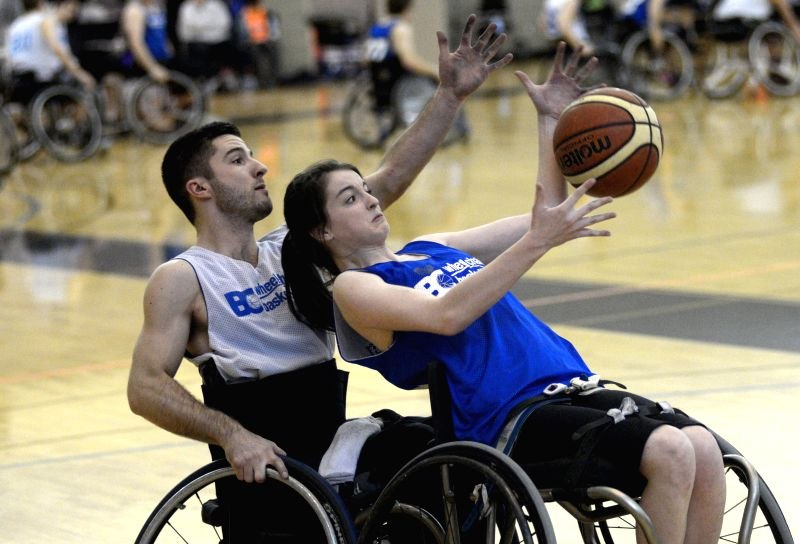 Team Canada's Paula Higgins (R) competes during the 2015 Junior Wheelchair Basketball Tournament in Burnaby, Canada, Jan.18, 2015. Canada's top school age ...