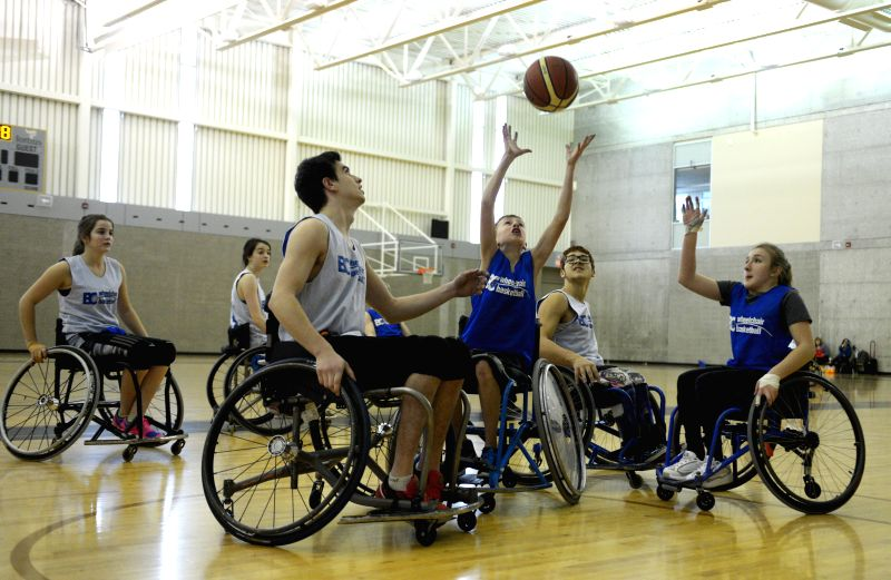 Young athletes compete during the 2015 Junior Wheelchair Basketball Tournament in Burnaby, Canada, Jan.18, 2015. Canada's top school age wheelchair basketball ...