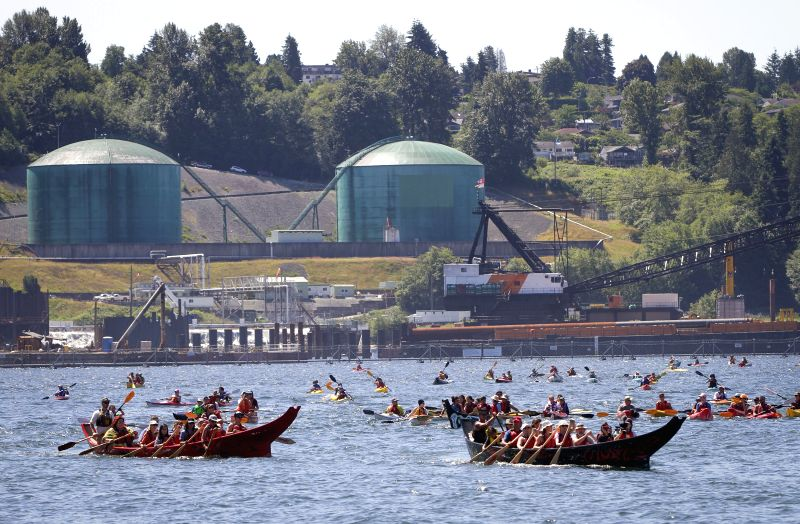 BURNABY, July 15, 2018 - Protesters  paddle in the water outside the Trans Mountain's Marine Terminal to protest against the Trans Mountain oil pipeline expansion that could affect the marine ...