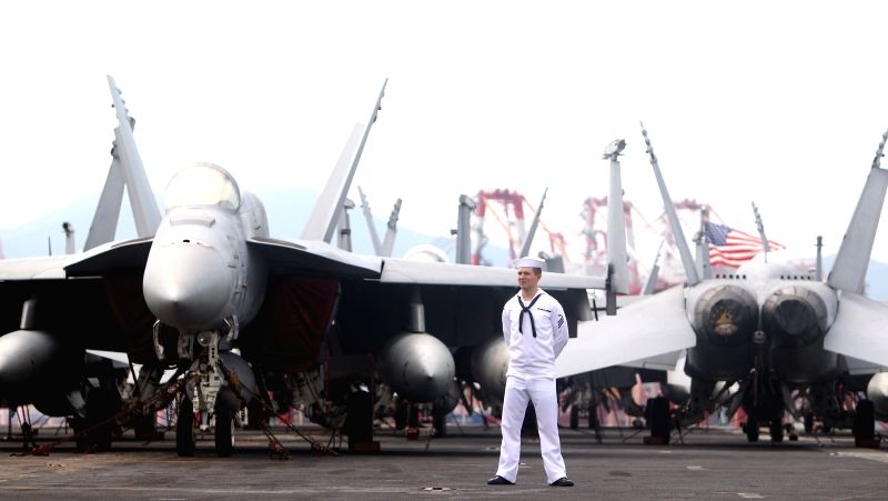 A crew member is seen on the flight deck of US nuclear powered aircraft carrier USS George Washington at a naval port in the southeastern port city of Busan, South ...