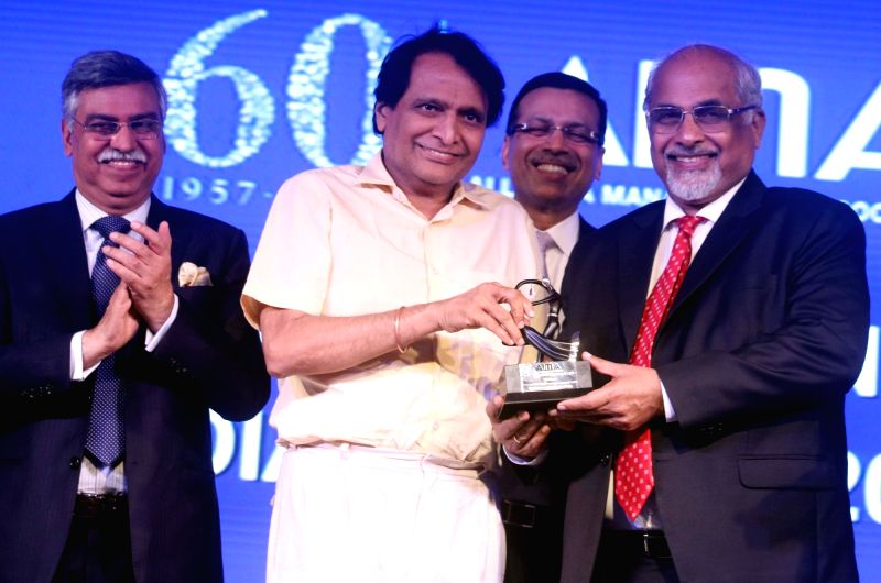 Business Standard Chairman and Editorial Director T. N. Nianan receives Lifetime Contribution to Media award from Union Railway Minister Suresh Prabhu at the AIMA Awards ceremony in New ... - Suresh Prabhu