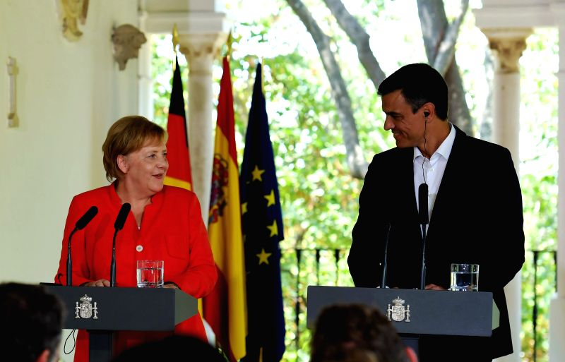 CADIZ (SPAIN), Aug. 11, 2018 Spanish Prime Minister Pedro Sanchez (R) and German Chancellor Angela Merkel attend a joint press conference in Sanlucar de Barrameda, Cadiz, Spain, on Aug. ... - Pedro Sanchez