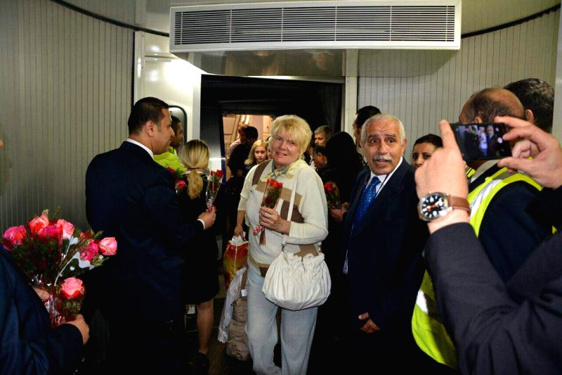 CAIRO, April 12, 2018 - Passengers from a plane of Russia's Airliner Aeroflot arrive at Cairo International Airport, Egypt, on April 11, 2018. Egypt and Russia resumed their direct flights on April ...