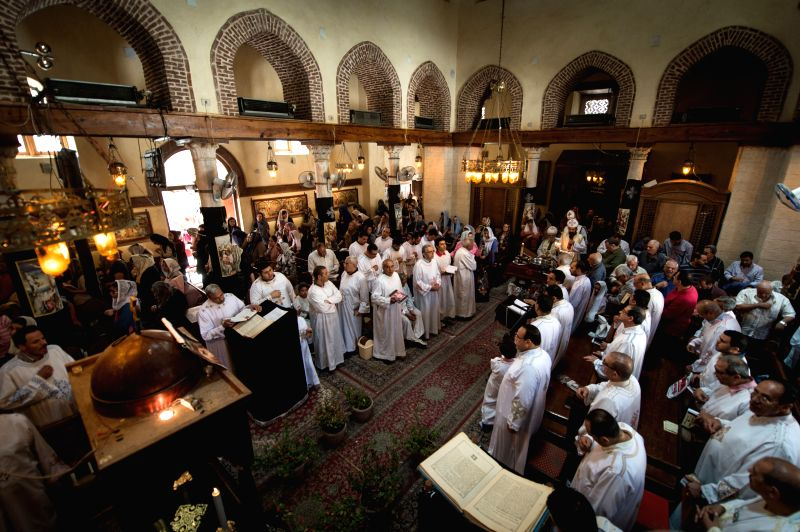 Egyptian Copts attend a mass on Holy Thursday at a church in Cairo, Egypt, on April 17, 2014. The Copts are the native Christians of Egypt. Holy Week in Christianity