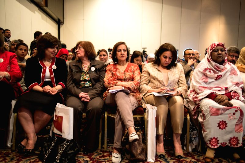 Representatives take part in a conference held by the General Federation of Women in Cairo, capital of Egypt, on April 17, 2014. Representatives from Arab countries,