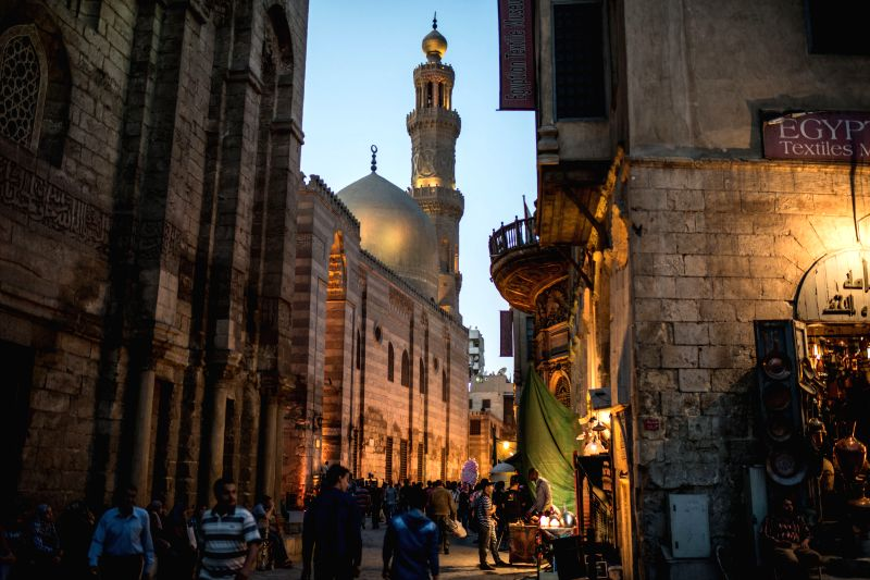 Egyptians visit the Al-Moez Street, which is one of the oldest streets in Cairo, as celebrating the World Heritage Day, in Egypt, on April 18, 2015. (Xinhua/Pan ...