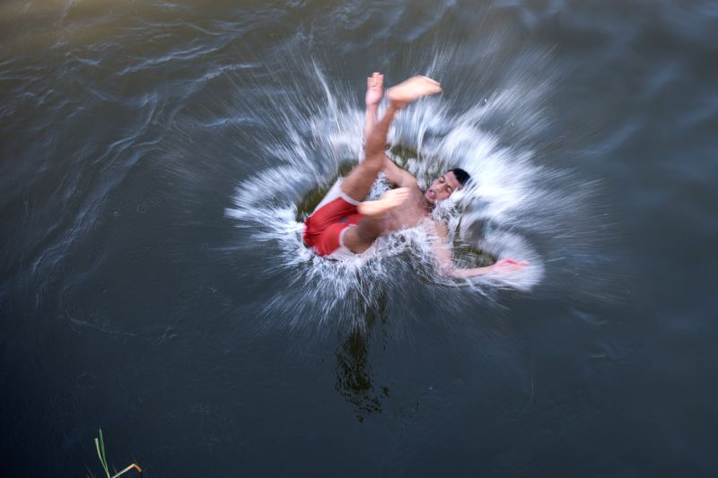 "CAIRO, April 18, 2017 - A boy dives into the Nile River to celebrate the traditional Egyptian festival ""Sham el-Nessim"" in Cairo, Egypt, April 17, 2017. Falling on the first Monday after ..."