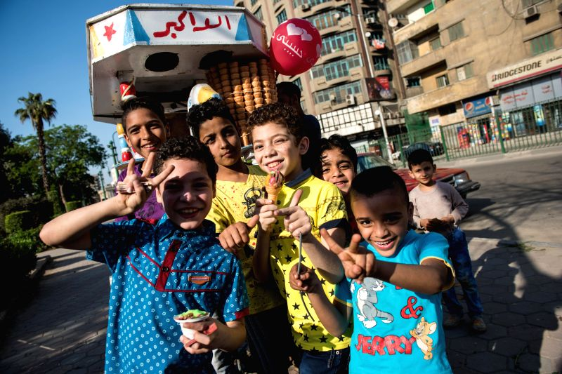 "CAIRO, April 18, 2017 - Children pose for photos during the traditional Egyptian festival ""Sham el-Nessim"" along the bank of Nile River in Cairo, Egypt, April 17, 2017. Falling on the first ..."