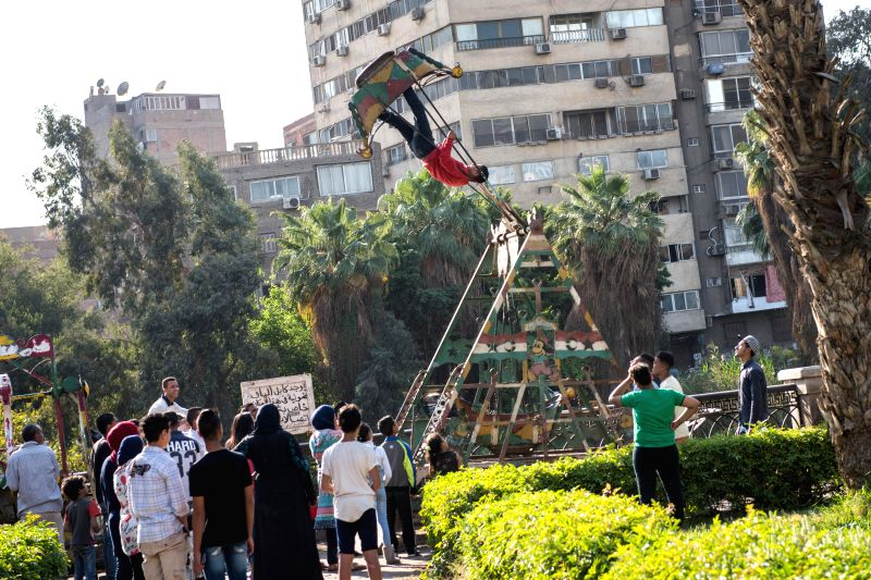 "CAIRO, April 18, 2017 - People celebrate the traditional Egyptian festival ""Sham el-Nessim"" along the bank of Nile River in Cairo, Egypt, April 17, 2017. Falling on the first Monday after ..."