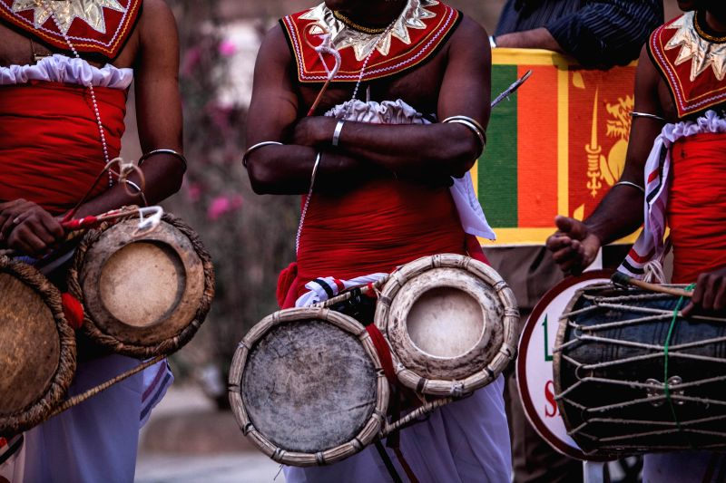 A drummer from Sri Lanka plays traditional drums during the opening ceremony of the International Drums Festival at the historical Salahuddien Citadel in Cairo, ...