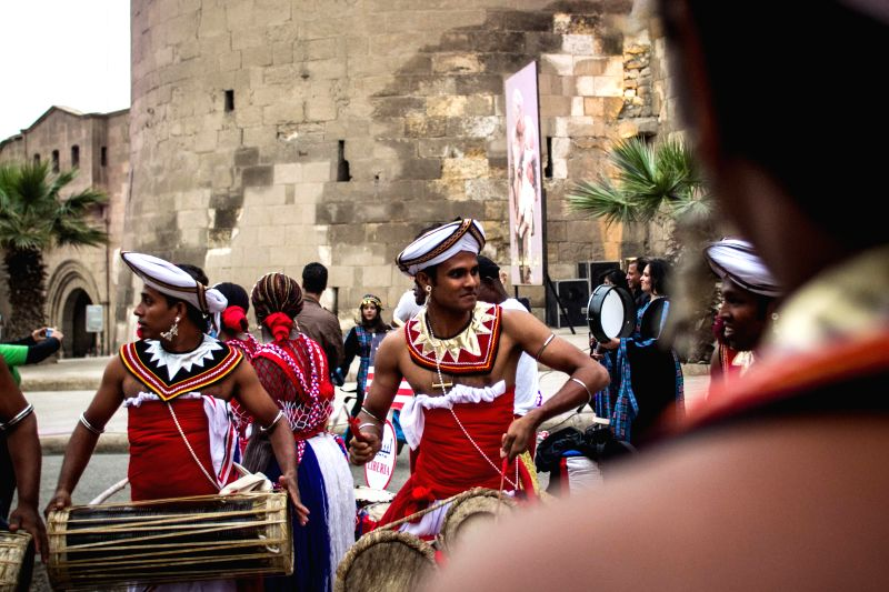 Performers from Sri Lanka are seen during the opening ceremony of the International Drums Festival at the historical Salahuddien Citadel in Cairo, Egypt, April 19, ..