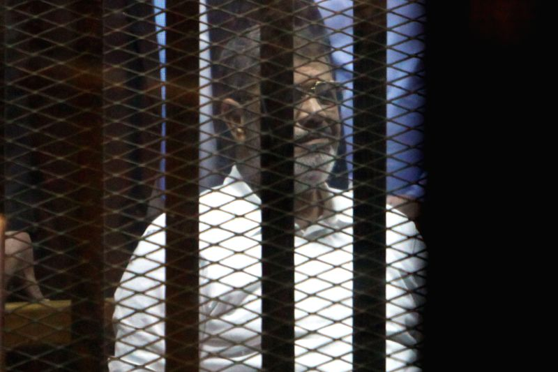 Egypt's ousted President Mohamed Morsi sits inside the defendants' cage at a court in Cairo, Egypt, on April 21, 2015. An Egyptian Court on Tuesday sentenced former ...