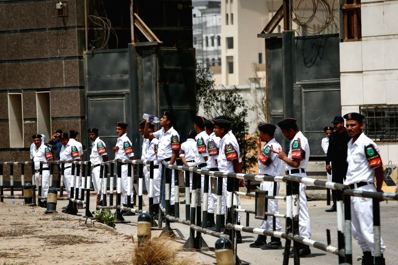 Egyptian police stand guard in front of the police academy where the Morsi trial takes place in Cairo, Egypt, April 21, 2015. An Egyptian Court on Tuesday sentenced ...