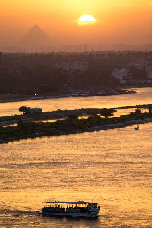People take a ferry to cross the River Nile in Cairo, Egypt, April 23, 2014.