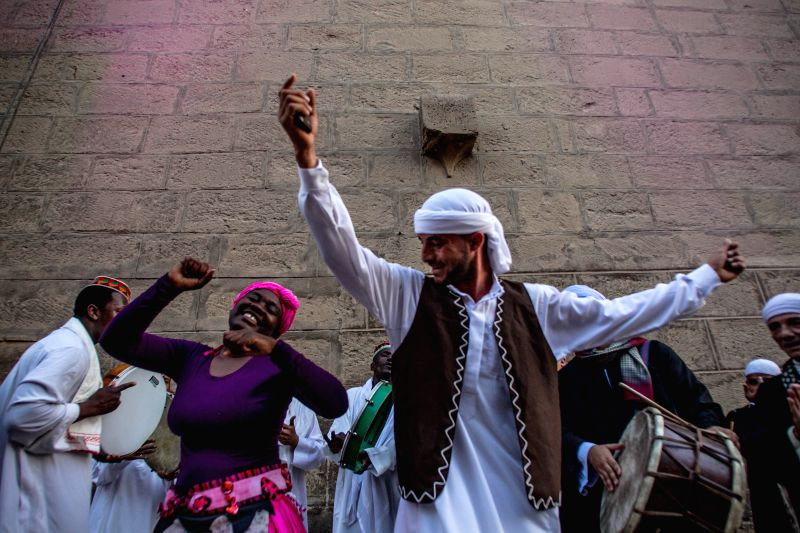 Performers from Egypt and Kenya dance during the closing ceremony of the International Drums Festival at the historical Salahuddien Citadel in Cairo, Egypt, April ...