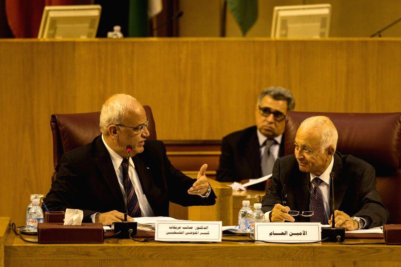 Saeb Oriqaat (L), executive committee's member of the Palestinian Liberation Organization, looks at Nabil al-Arabi (R),  secretary general of the Arab League, while ..