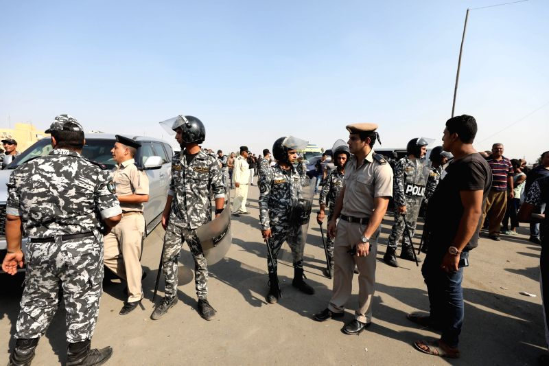 CAIRO, Aug. 11, 2018 - Police officers stand guard at the site where a suicide bomber detonated his explosive belt in Cairo, Egypt, Aug. 11, 2018. Egyptian forces have thwarted on Saturday an ...