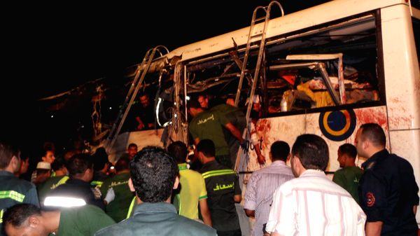 People gather at the site of a bus crash in Egypt's South Sinai province, Aug. 22, 2014. At least 33 people were killed and over 40 others seriously wounded in the ...