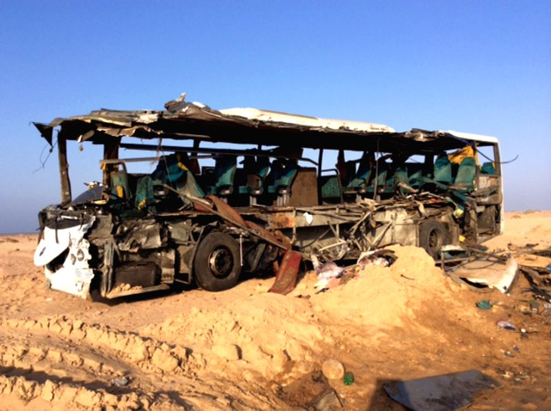 Photo taken on Aug. 22, 2014 shows the wreckage of a bus in Egypt's South Sinai province. At least 33 people were killed and over 40 others seriously wounded in the ..