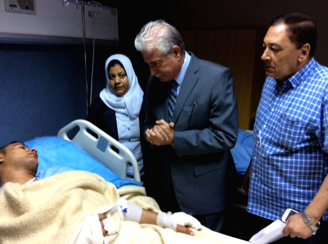 South Sinai Governor Khaled Fouda (C) visits an injured person at a hospital in Egypt's South Sinai province, Aug. 22, 2014. At least 33 people were killed and over ..