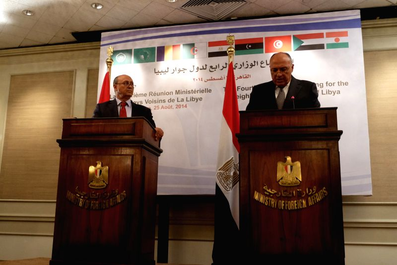 Egyptian Foreign Minister Sameh Shoukri (R) and Libyan Foreign Minister Mohammed Abdel Aziz answer questions during a press conference in Cairo, Egypt, on Aug. 25, ... - Sameh Shoukri