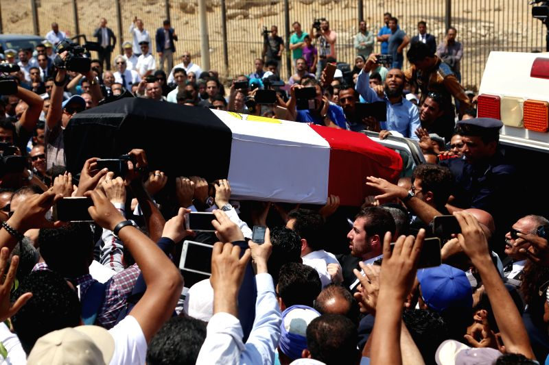 CAIRO, Aug. 7, 2016 - People carry Ahmed Zewail's coffin during a funeral in Cairo, Egypt, Aug. 7, 2016. The body of Egypt's Nobel laureate Ahmed Zewail arrived Saturday from the United States to ...