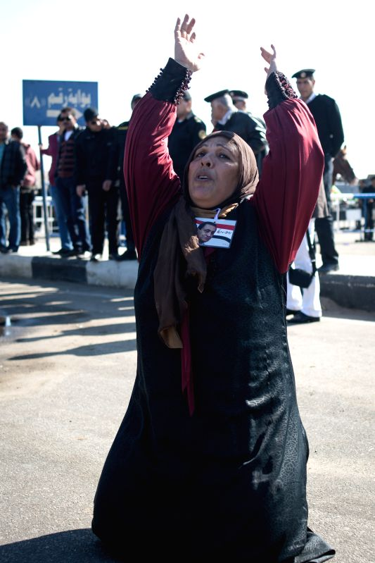 Cairo (Egypt): A Mubarak supporter cries after the court dismissed charges against Egypt's former president Hosni Mubarak and acquitted five of his security aides outside a court in Cairo, Egypt, ...