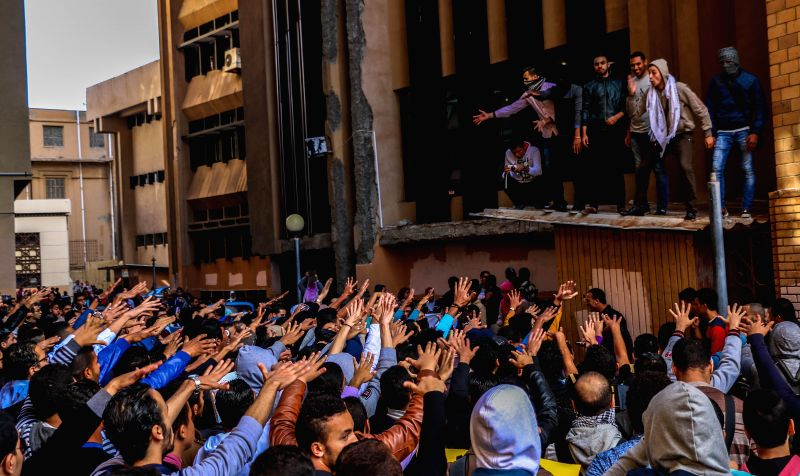 Cairo (Egypt): Students from Alexandria University participate in a demonstration against Mubarak's verdict in Alexandria, costal city of Egypt, on Nov. 30, 2014. An Egyptian criminal court on ...