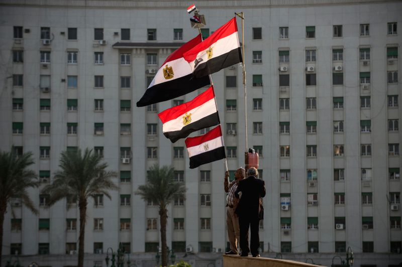 Cairo (Egypt): Supporters of Egyptian military wave flags during a pro-military demonstration at Tahrir Square in Cairo, Egypt, on Nov. 28, 2014. A heavy sound of explosion was heard on Friday ...