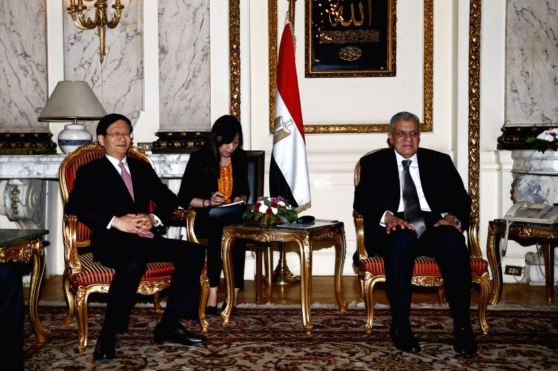 Egyptian Prime Minister Ibrahim Mahlab (R) meets with Meng Jianzhu (L), special envoy of Chinese president Xi Jinping, also a member of the Political Bureau of the Communist Party of China ...