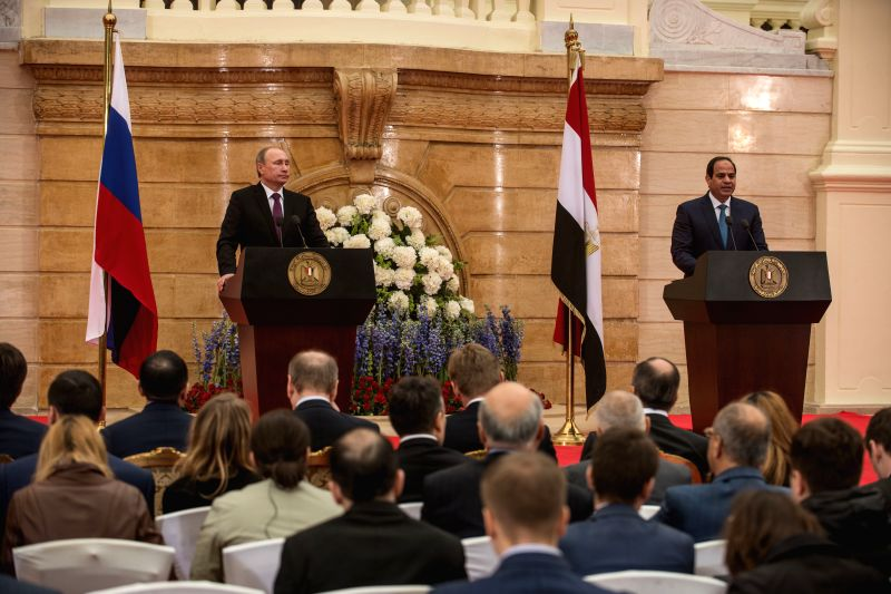 The visiting Russian President Vladimir Putin(L) and Egyptian President Abdel-Fattah al-Sisi attend a joint press conference after their meeting in Koba Palace, ...