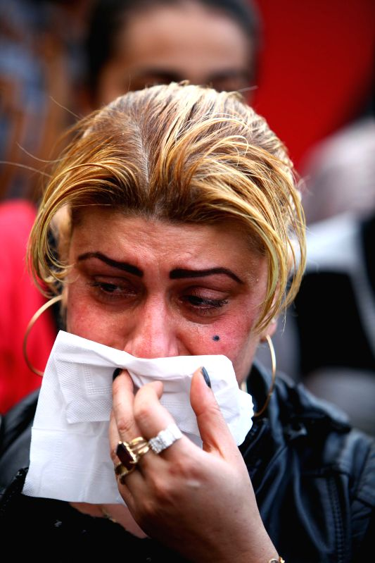 A protestor reacts during a demonstration mourning for the victims purportedly murdered by Islamic State (IS) group militants in Libya, in Cairo, Egypt, on Feb. 16, ..