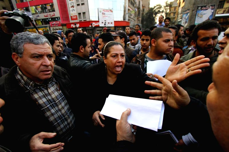 Protestors react during a demonstration mourning for the victims purportedly murdered by Islamic State (IS) group militants in Libya, in Cairo, Egypt, on Feb. 16, ...