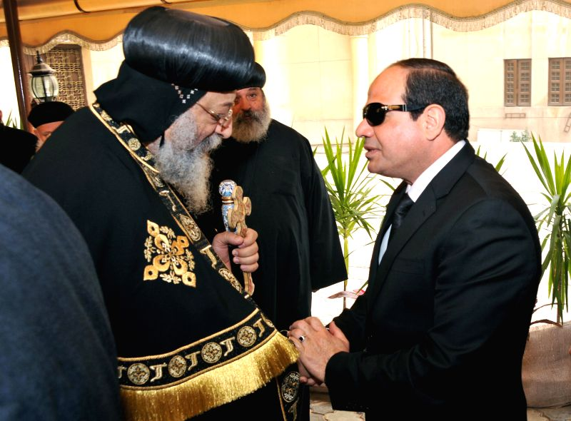 The photo released by Egyptian state-run news agency MENA shows that Egyptian President Abdel Fattah al-Sisi (R) offers his condolences to Egypt's Coptic Pope ...